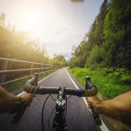 Really fast racing bicycle ride on mountain road. Action cam on a chesty mount for a POV filming view.