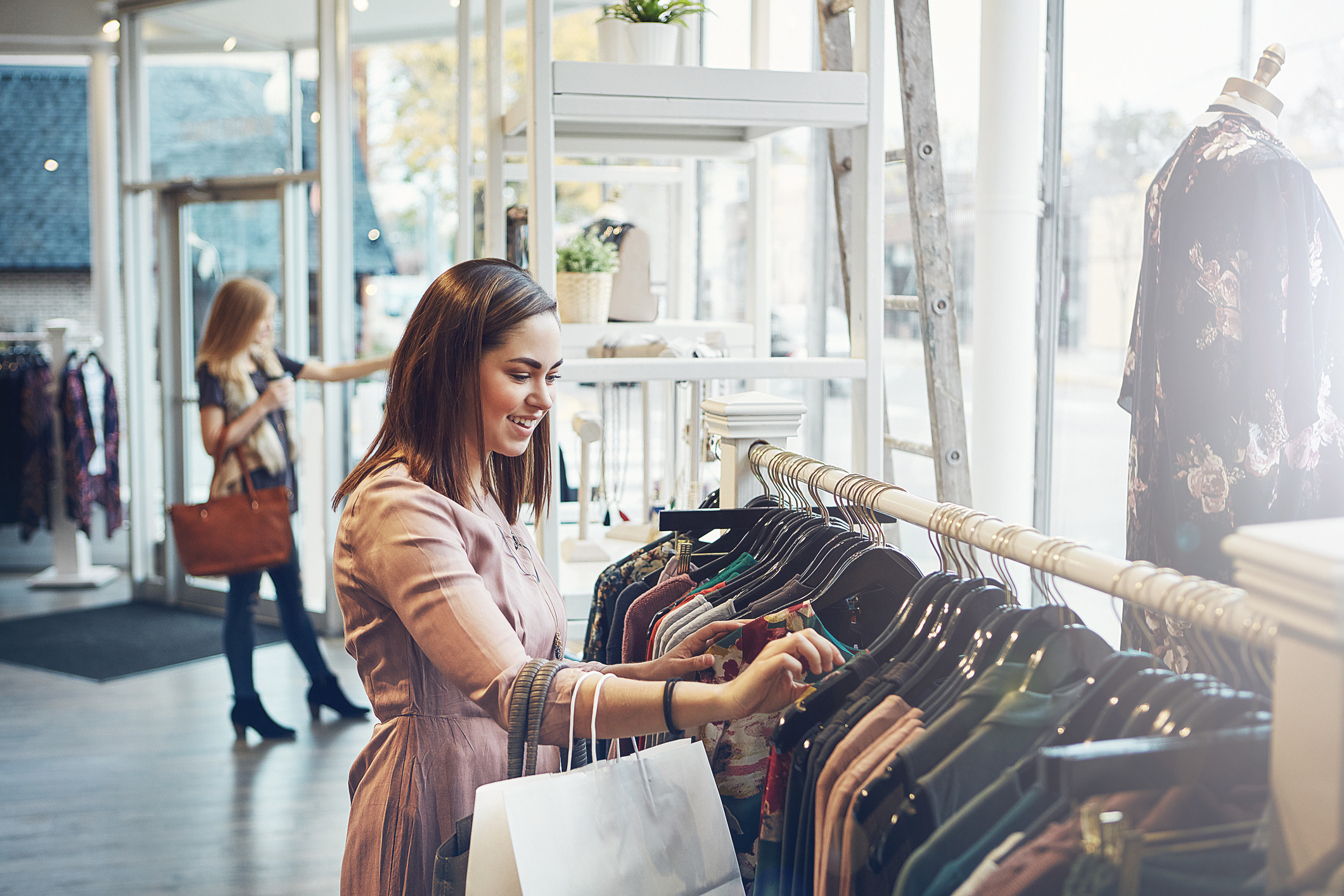 Shot of a young woman shopping at a clothing store